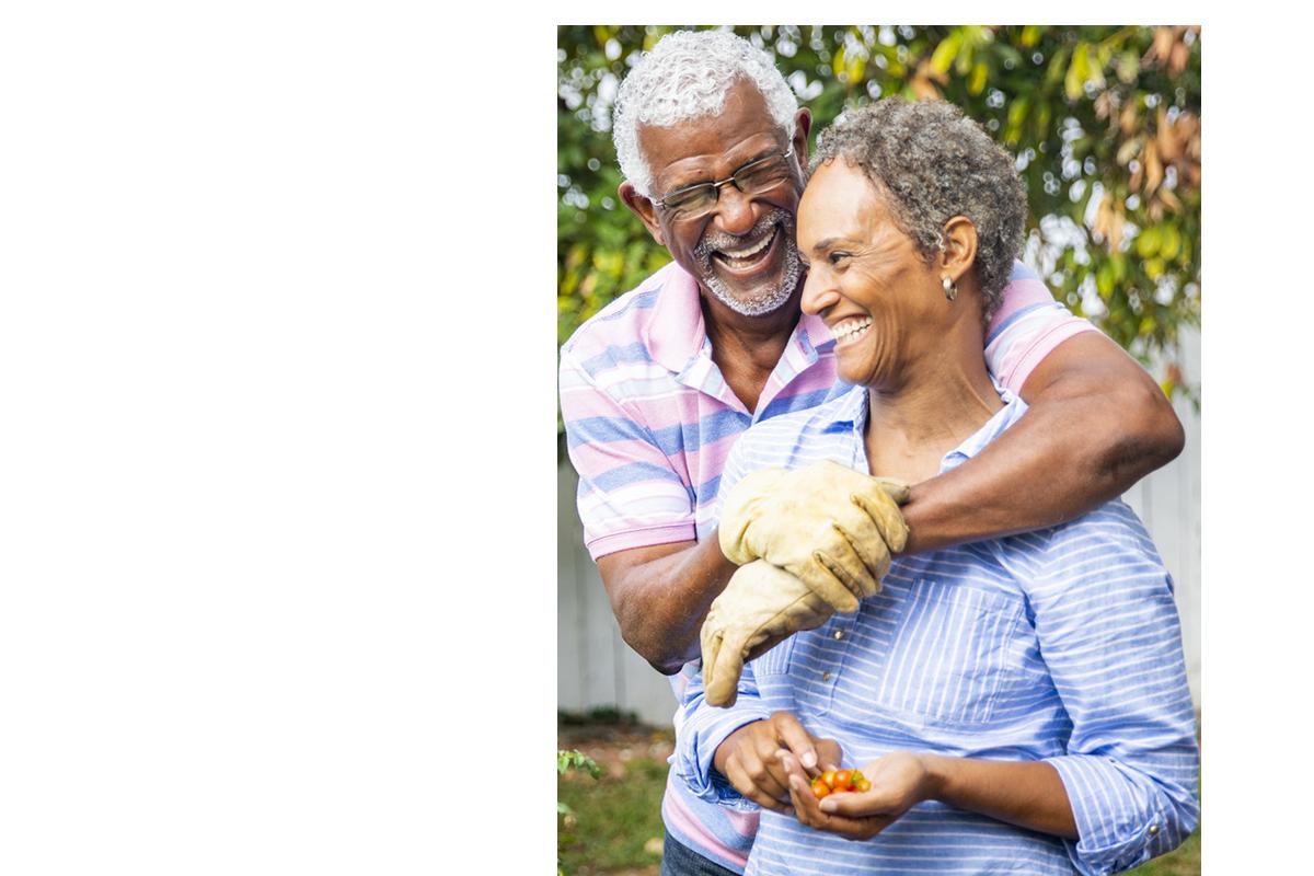 Senior African American couple gardening