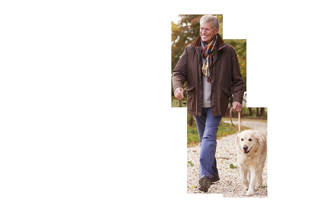 Mature man walking with dog