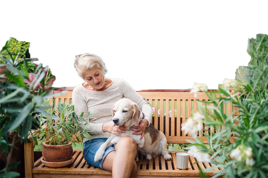 Senior woman with dog on bench