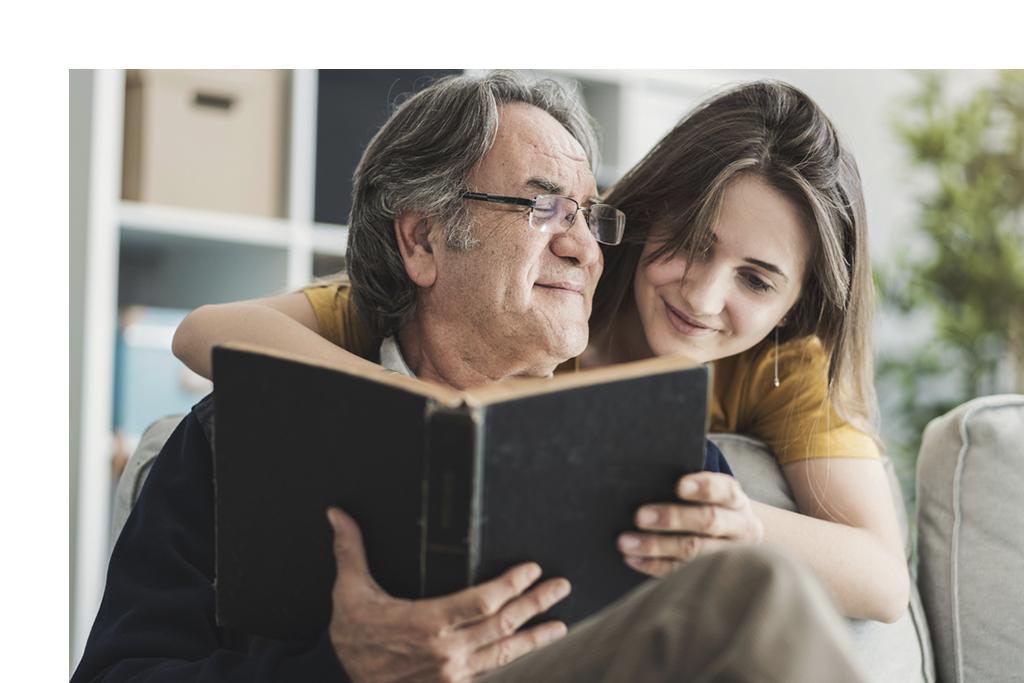 Senior man reading with daughter